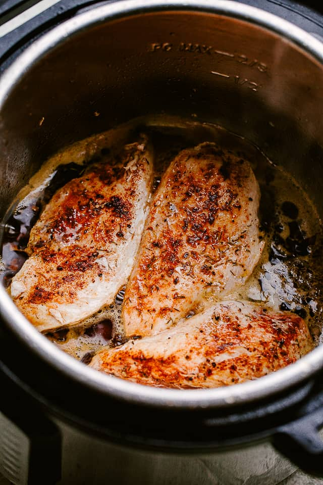 Instant pot with cooked chicken breasts inside
