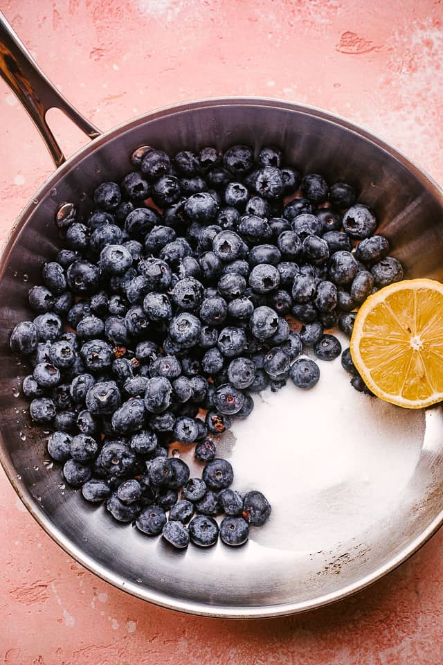 Skillet with blueberry sauce ingredients