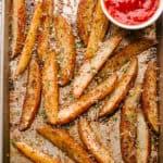 Baking sheet with crispy potato wedges