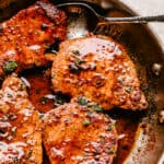 Skillet with pan fried pork chops