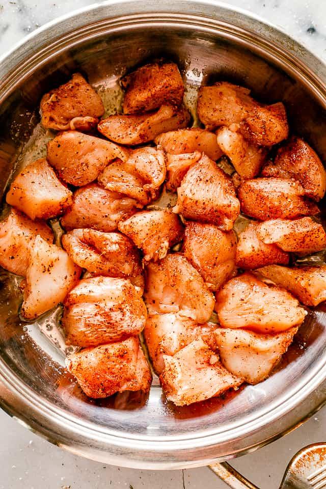 Skillet with seasoned chicken breast bites