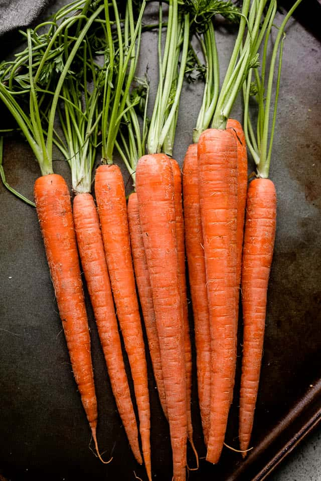Raw bunch of carrots, ready to be prepped for roasting.