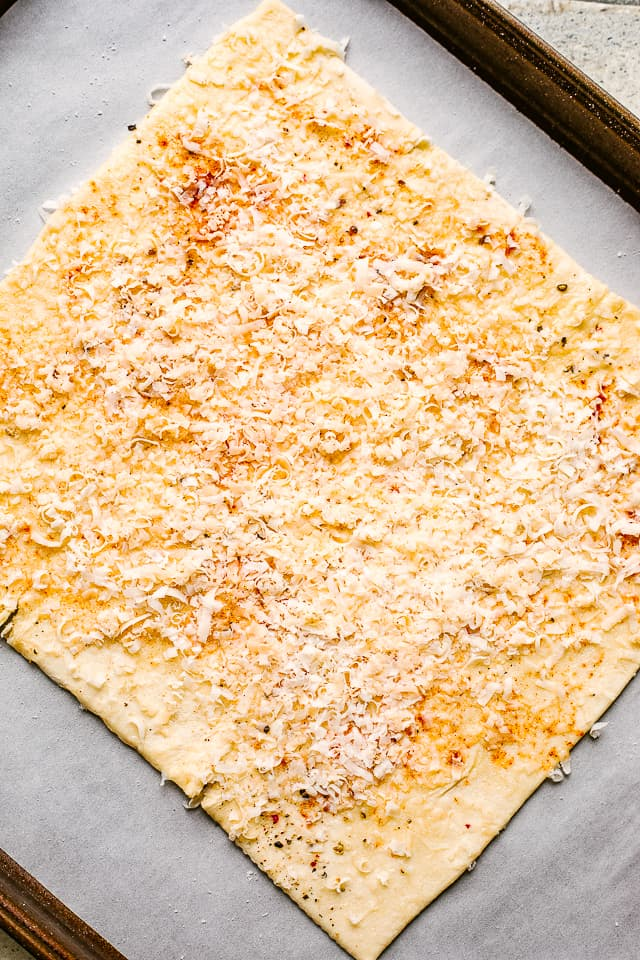 Puff pastry layered with cheese and spices.