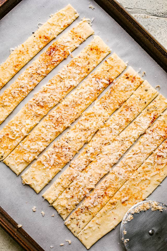 Puff pastry layered with spices and cheese, then sliced.