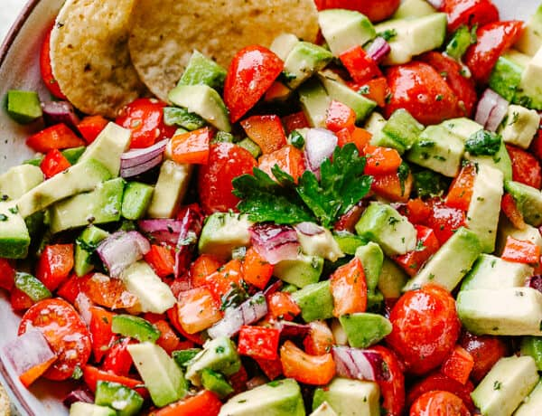 bowl filled with chopped tomatoes, chopped avocado, and tortilla chips
