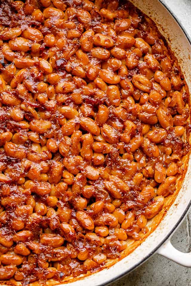 pot of baked beans topped with bacon