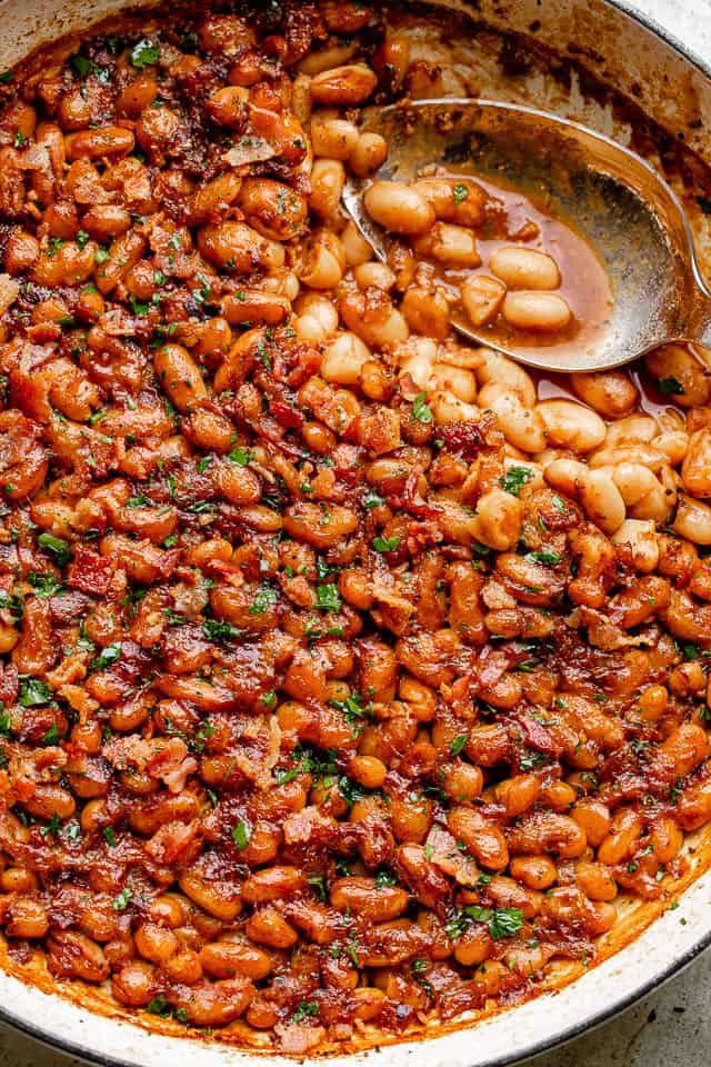 Pot of homemade maple bacon baked beans.