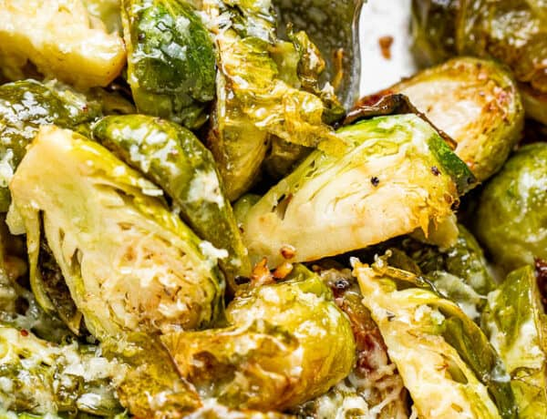 scooping out brussel sprouts from the slow cooker