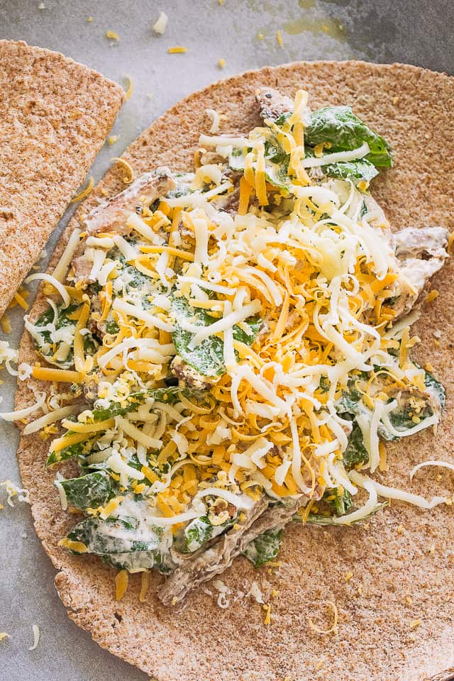 flour tortillas  layered with a creamy spinach and chicken mixture and topped with shredded cheese