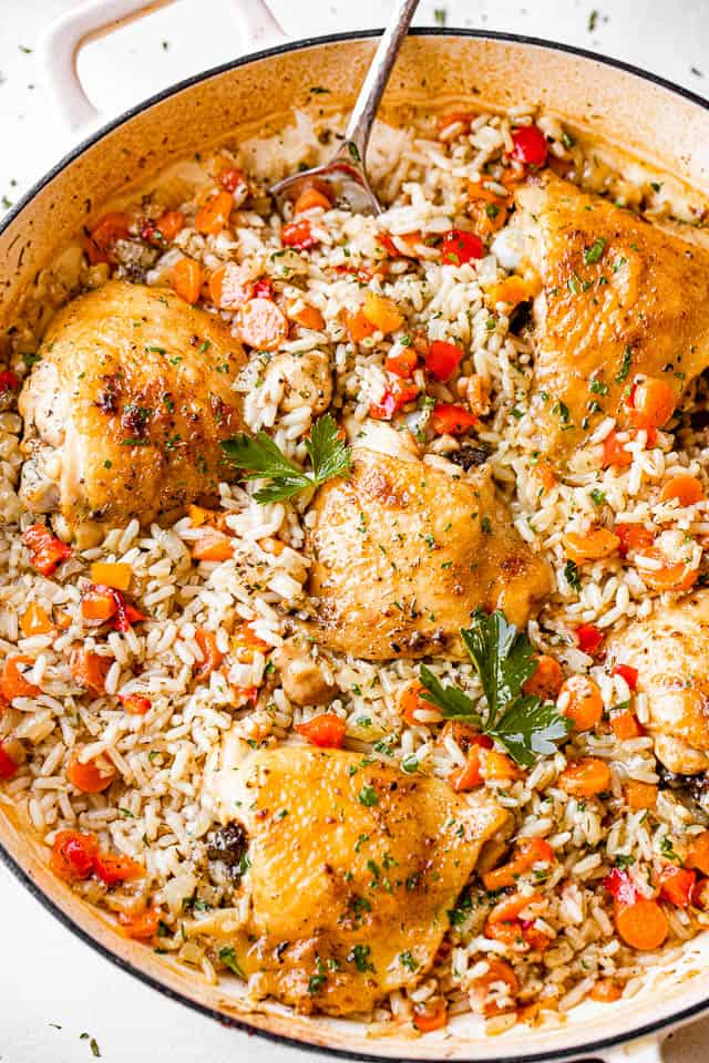 top view of chicken thighs, rice, and vegetables in a pan