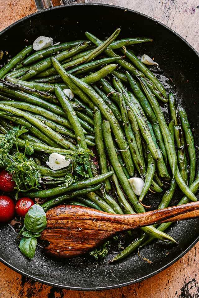 green beans cooking in a black skillet