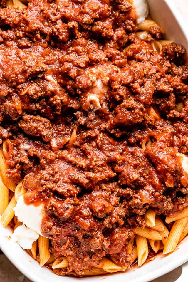 ground beef tomato sauce poured over penne pasta