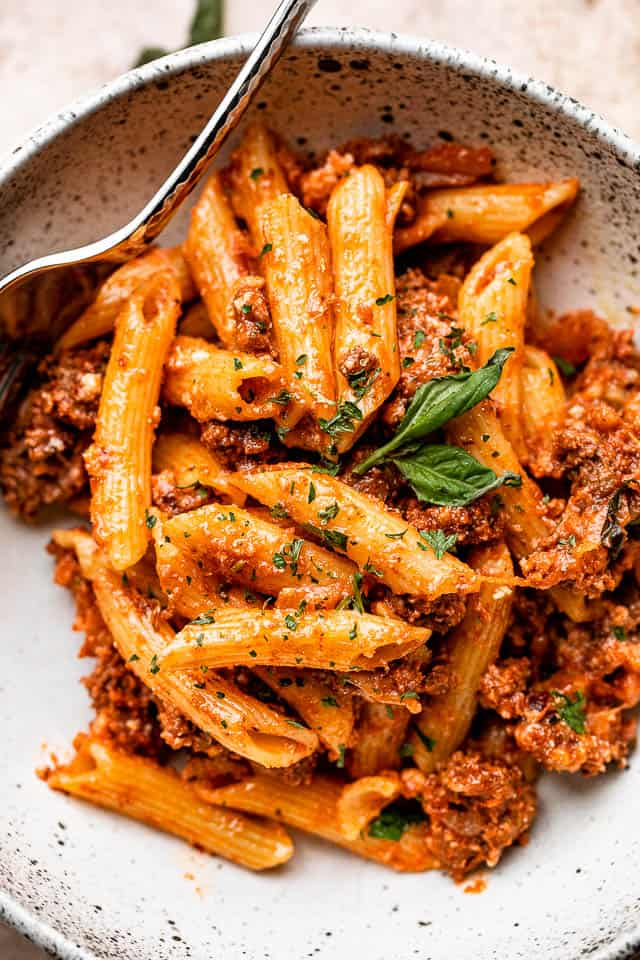 Bowl with ziti pasta and ground beef casserole