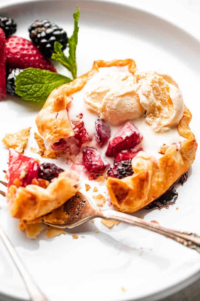 side view f berries stuffed in a mini galette and topped with ice cream