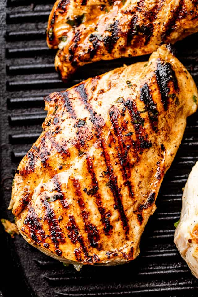 chicken breast with grill marks set on a black grill pan