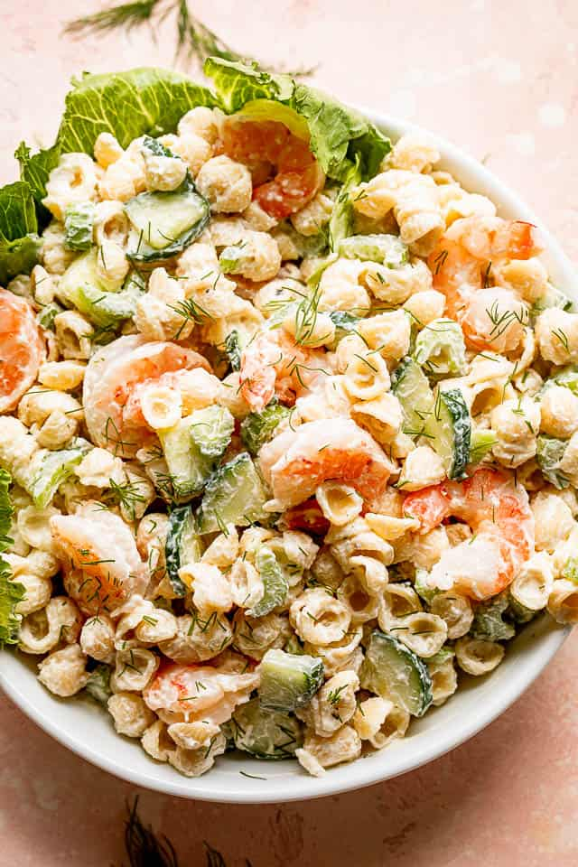 top view of a Creamy Shrimp Pasta Salad in a white salad bowl
