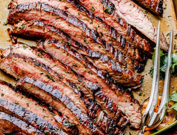 top shot of grilled steak slices with a serving fork next to it
