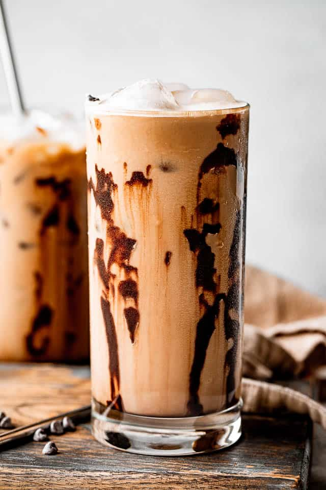 side shot of drinking glasses filled with iced coffee