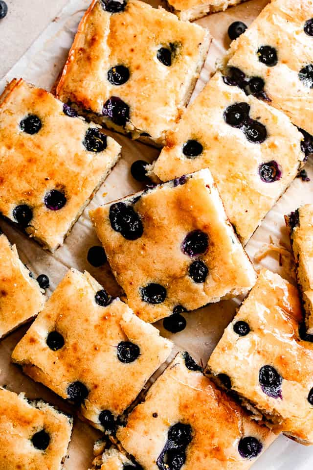 sheet pan pancakes topped with blueberries and cut into squares