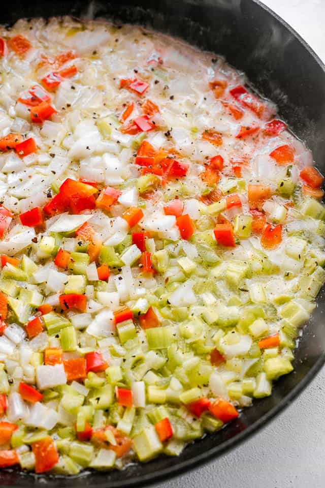 frying diced red peppers and diced celery in butter