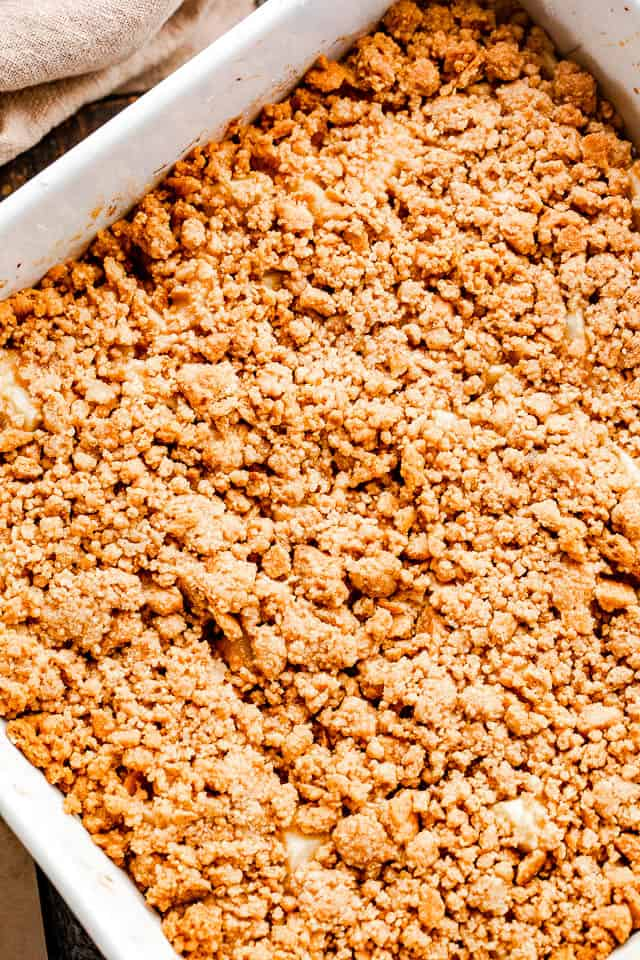 overhead shot of an apple crumble topped with graham cracker crust