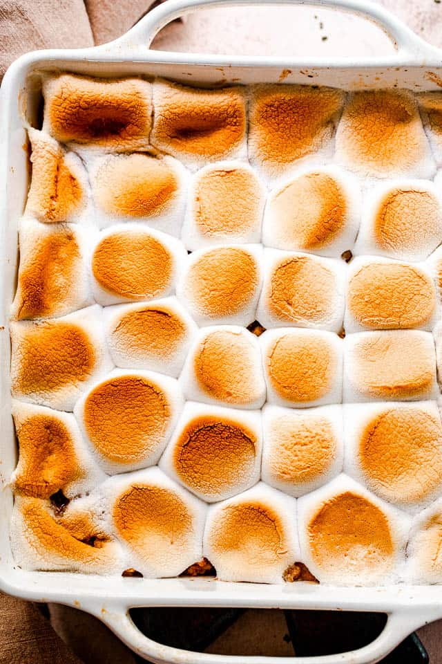 overhead shot of an apple crumble topped with toasted marshmallows