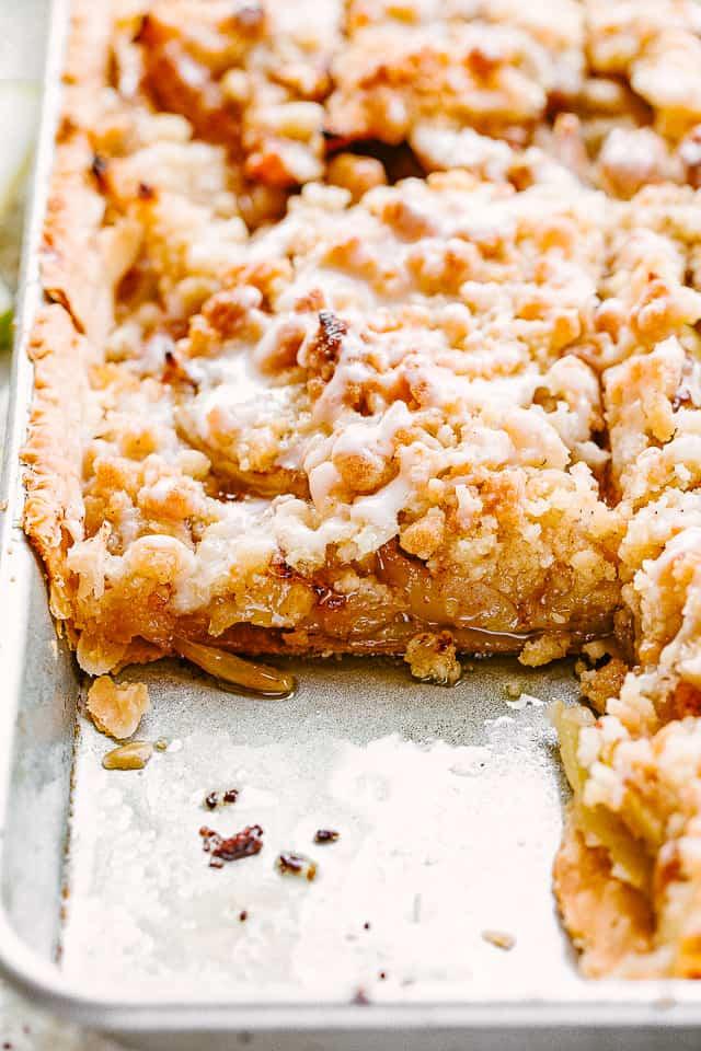 side shot of apple slab pie in a sheet pan.