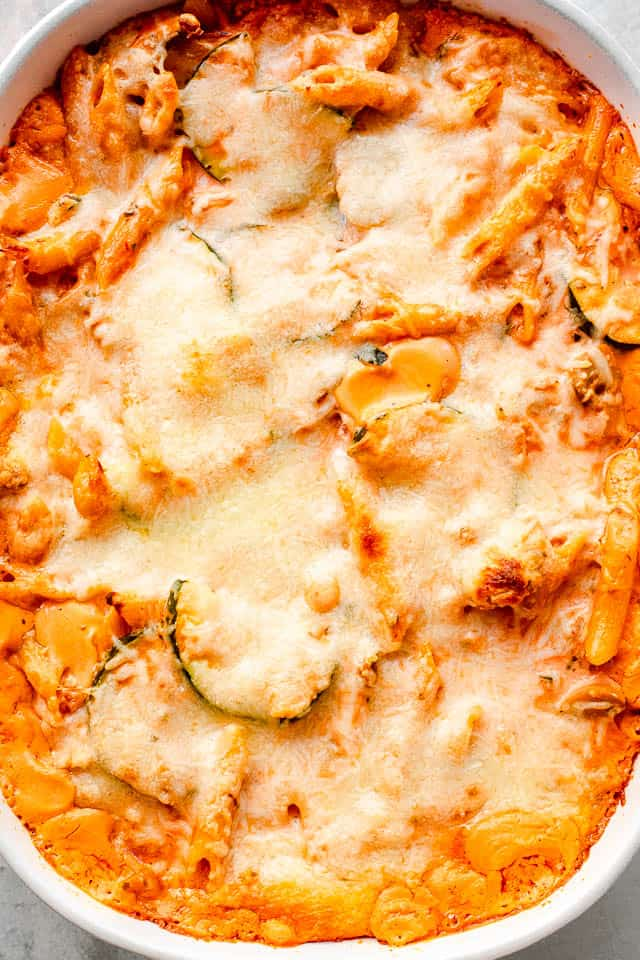 top overhead shot of a cheesy covered baked pasta and zucchini casserole
