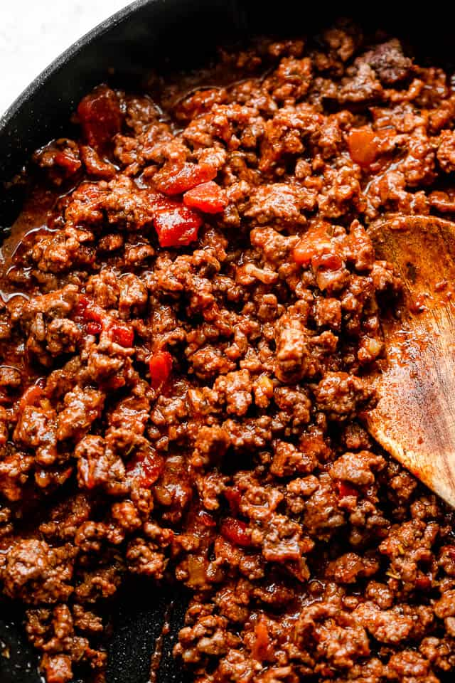 top shot of cooking ground beef in a black skillet
