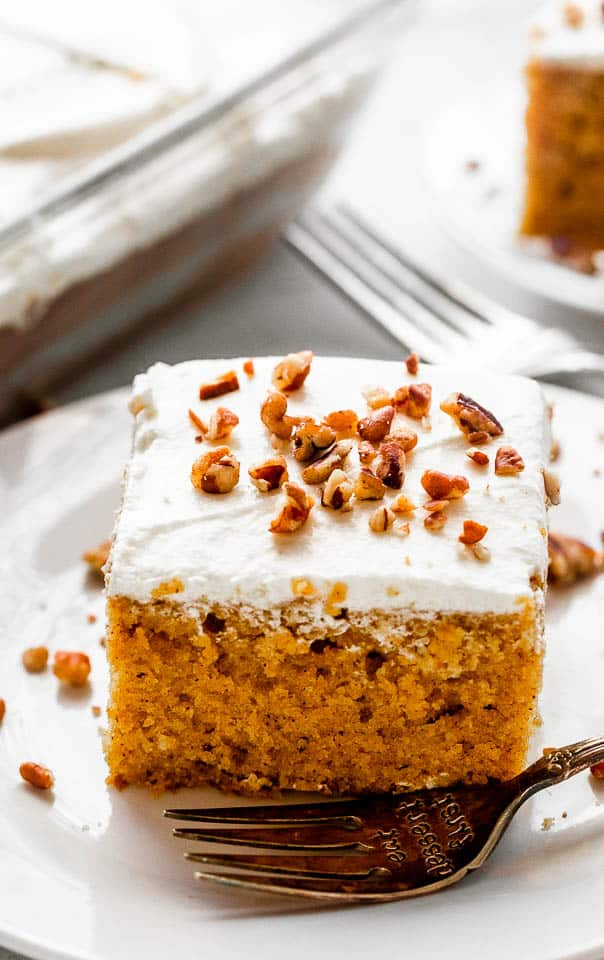 pumpkin bar slice topped with cream cheese frosting a chopped pecans