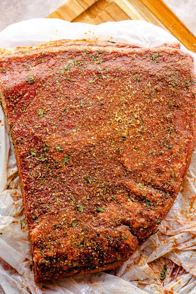 top shot of seasoned raw beef brisket