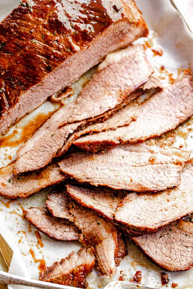 top view of sliced beef brisket set on parchment paper