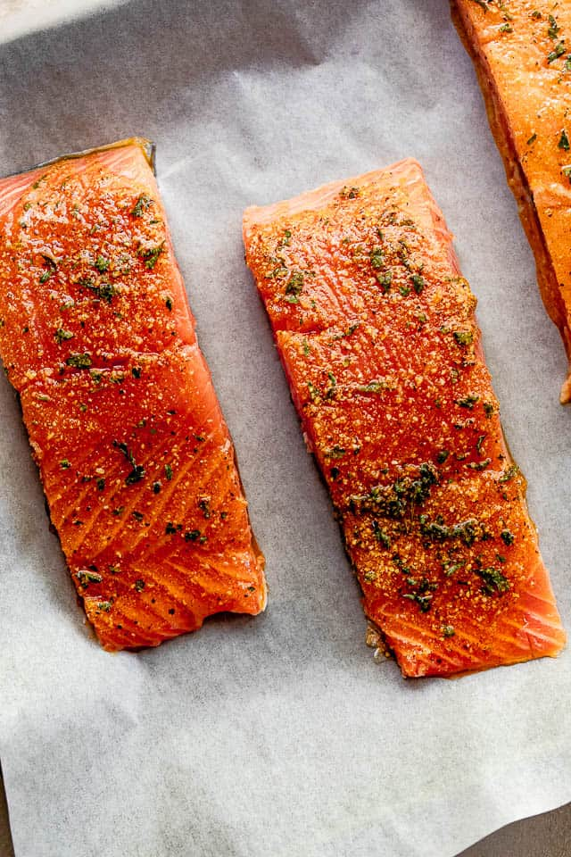 overhead shot of seasoned raw salmon fillets