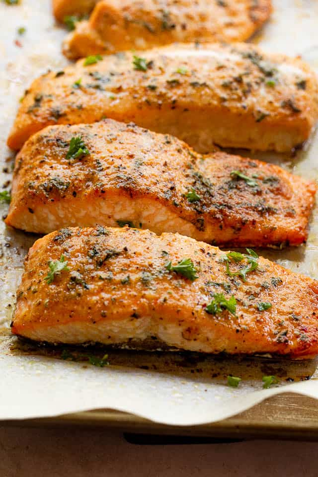 side shot of cooked salmon fillets seasoned with old bay seasoning