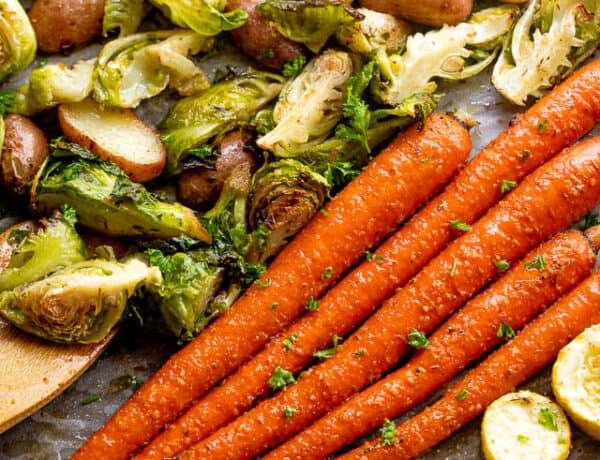 overhead shot of roasted vegetables on a baking sheet