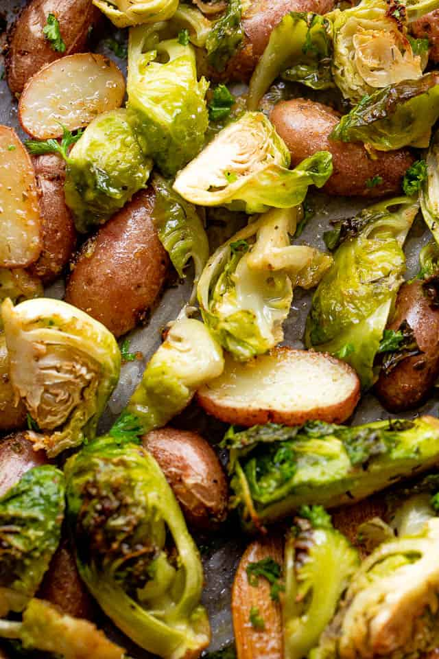 close up overhead shot of cooked brussel sprouts and fingerling potatoes