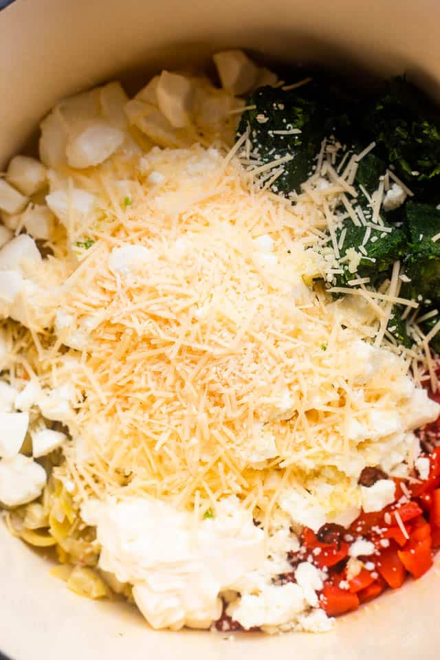 overhead shot of ingredients for spinach artichoke dip in slow cooker