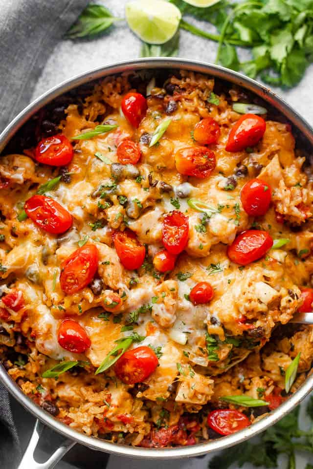 overhead shot of chicken and rice burrito skillet topped with grape tomatoes