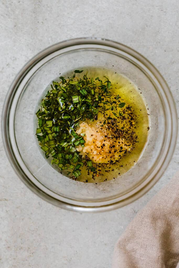 glass bowl with marinade for chicken