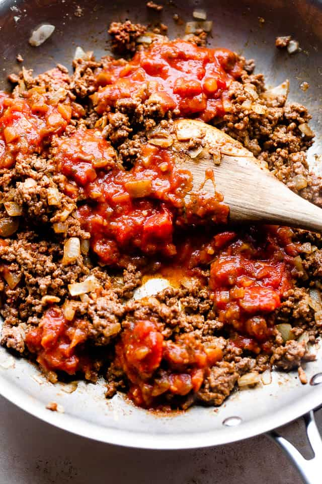 overhead shot of preparing ground beef with salsa in a skillet