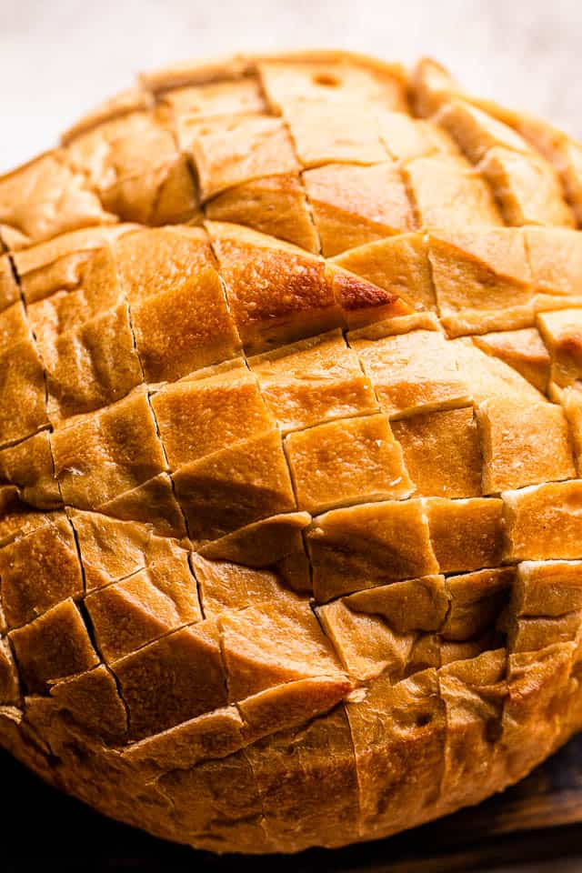 crosshatched round loaf of bread