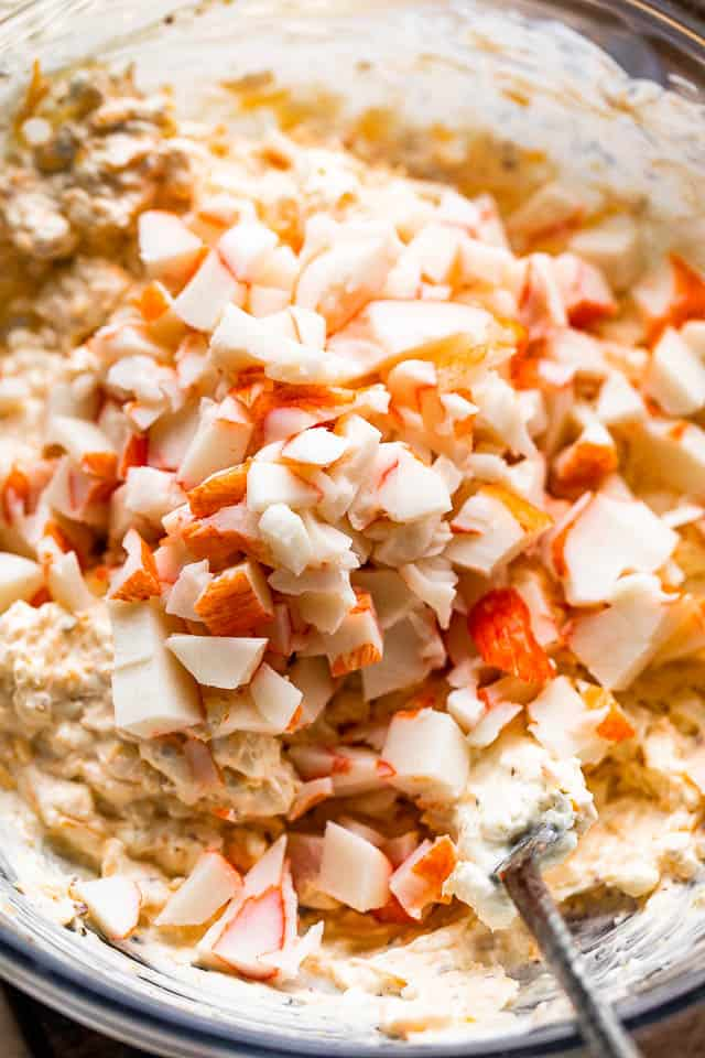 mixing crab meat into cream cheese