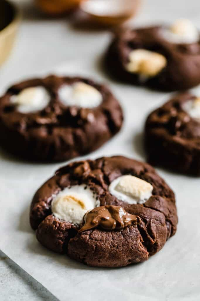 Four Chocolate Marshmallow Cookies on a Sheet of Parchment