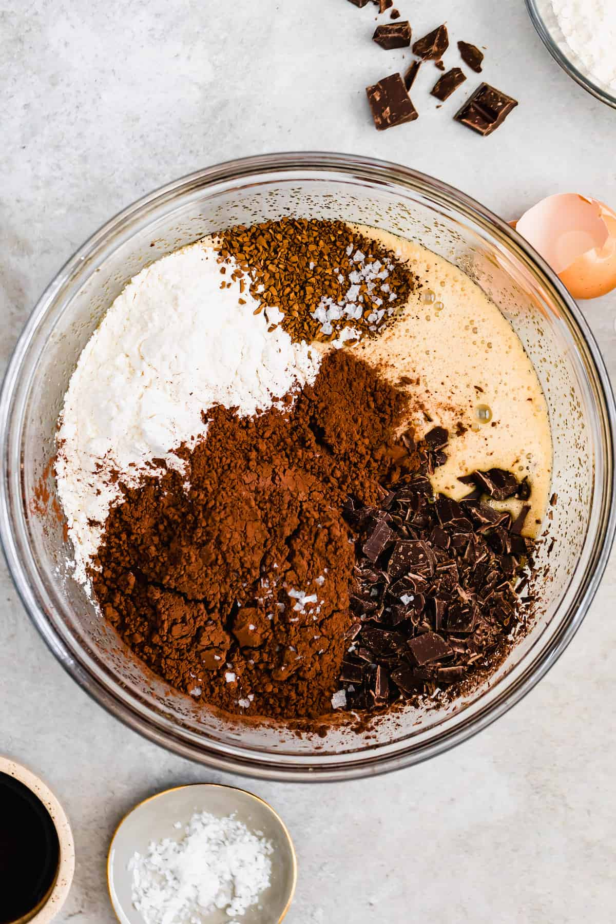 A Glass Bowl of Brownie Batter with the Chocolate and Dry Ingredients Added, But Not Mixed In