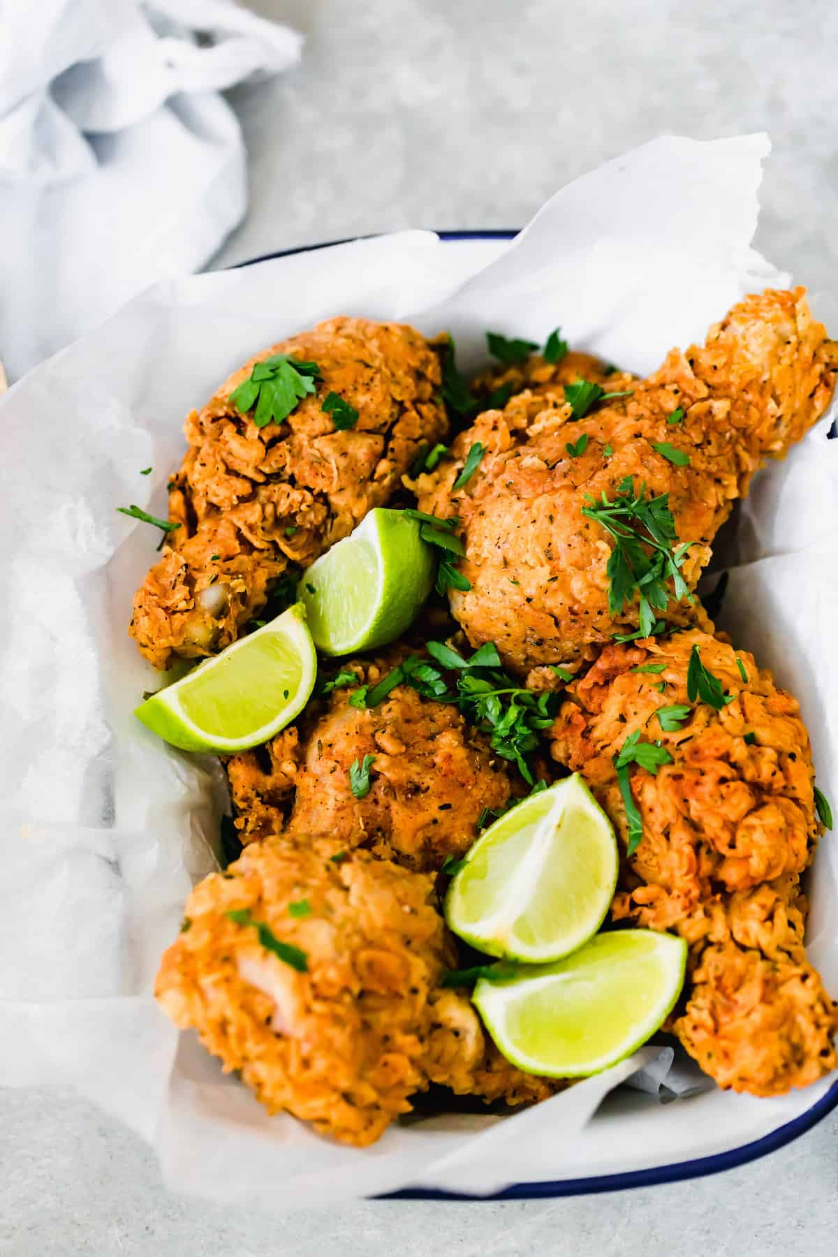 Fried Chicken in a Dish Lined with A Piece of Parchment Paper