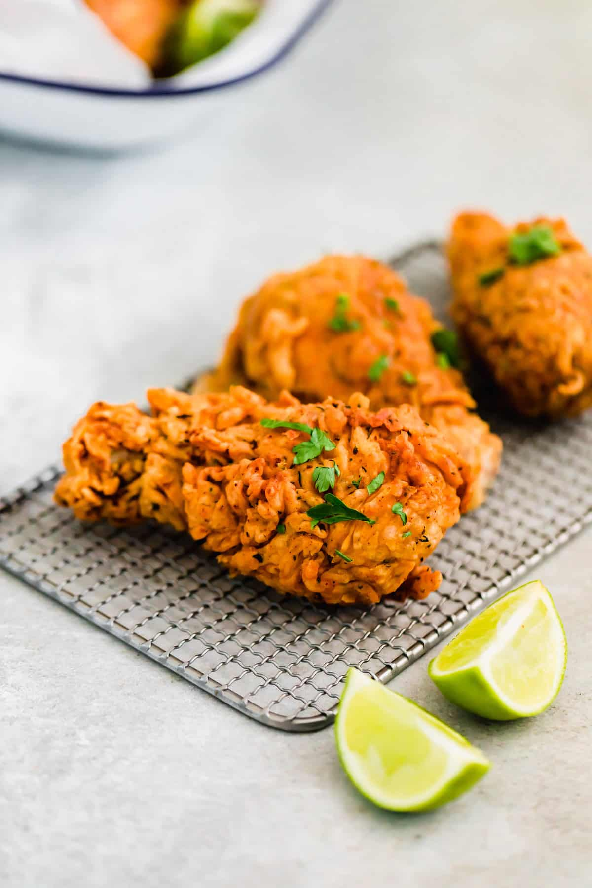 Three Pieces of Buttermilk Fried Chicken Garnished with Chopped Parsley