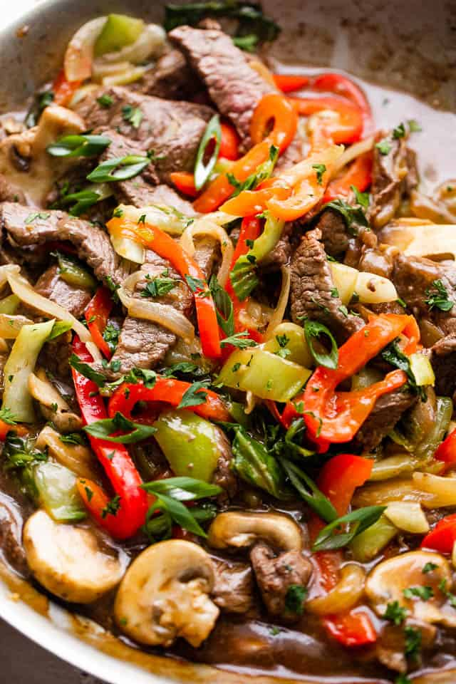 close up photo of beef stir fry with bell peppers, bok choy, mushrooms, and pepper