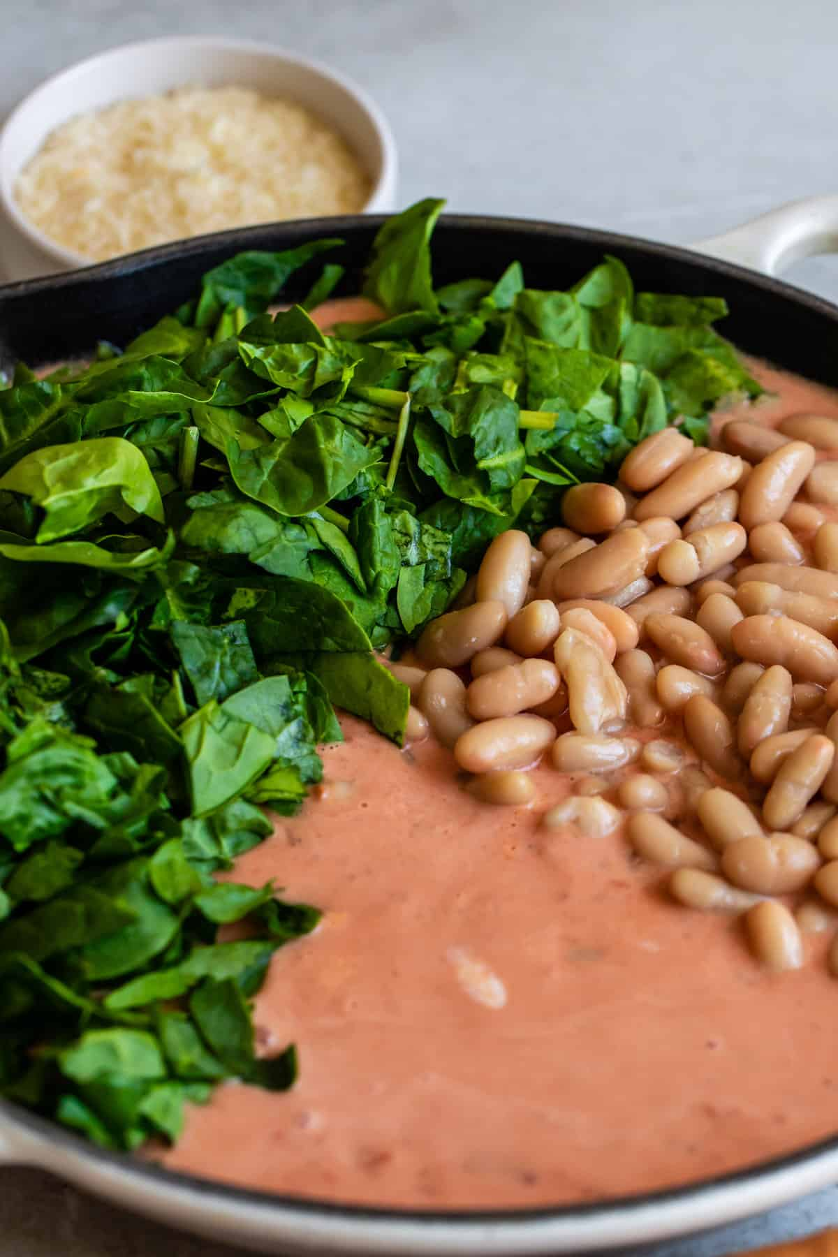 Spinach and Beans Added to the Skillet of Tuscan Rigatoni Sauce