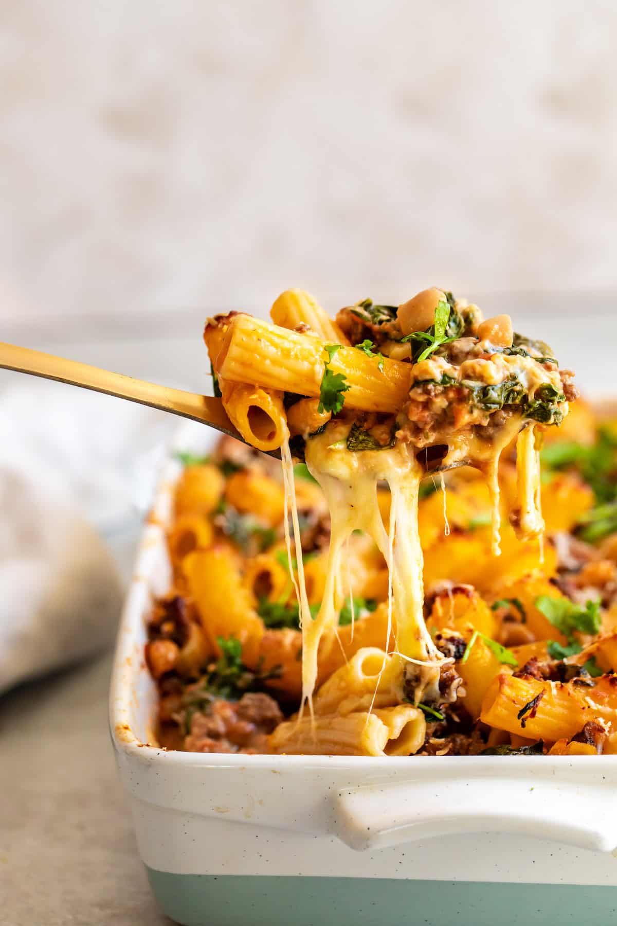 A Spoonful of Rigatoni Casserole Being Lifted From the Pan