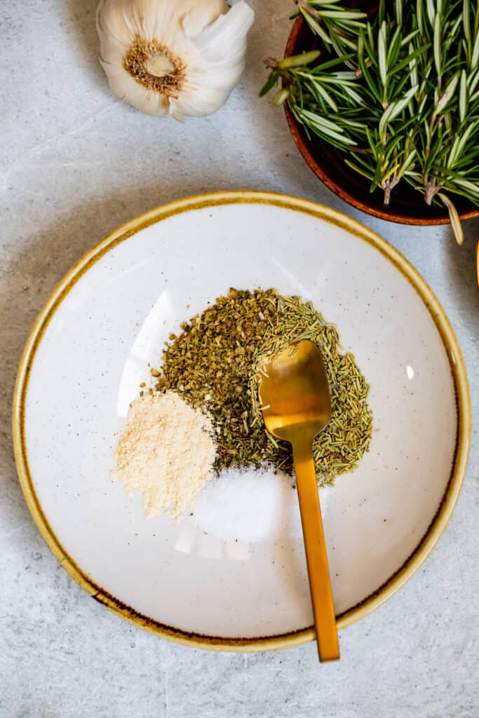 Seasoning herbs in a gold trimmed plate